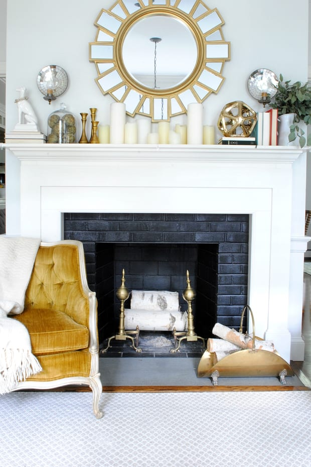 This simple fireplace and mantel decor is cool toned but perfect for fall
