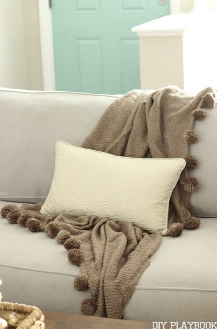 cool-toned throw blanket and pillow