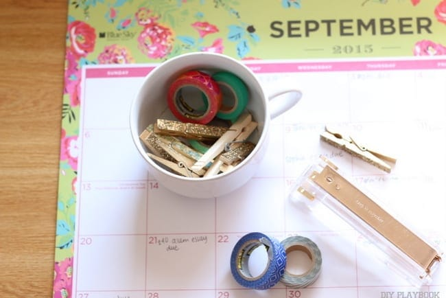 A desktop calendar, tape and other office supplies help college students stay organized.