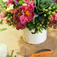 having some fun creating gorgeous flower centerpieces