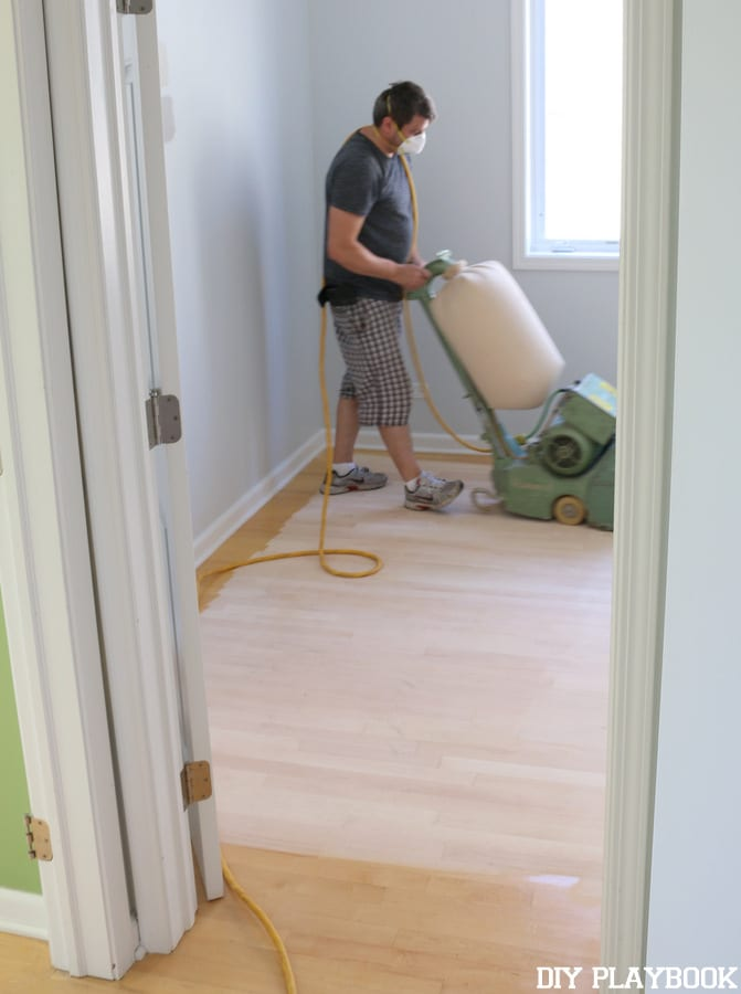 The first step to refinishing the hardwood floors was to have them sanded.