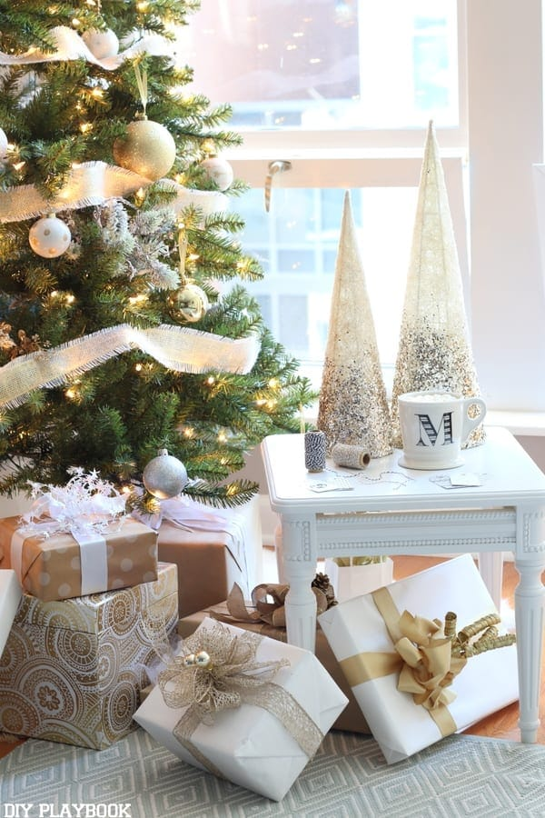 Glamorous Christmas Tree complete with gold ribbon, gold and white ornaments and tons of silver accents!