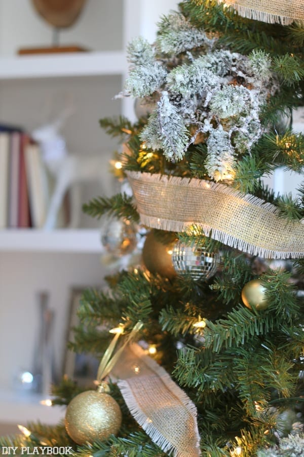 We love this gold burlap ribbon we used to wrap all the way around the tree.