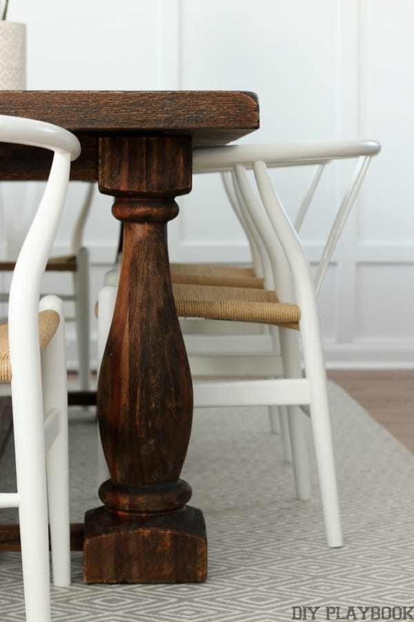 Details of the dining room table with chairs.