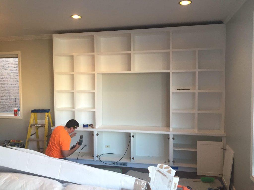built-ins-bookshelf-worker-diy-contractor