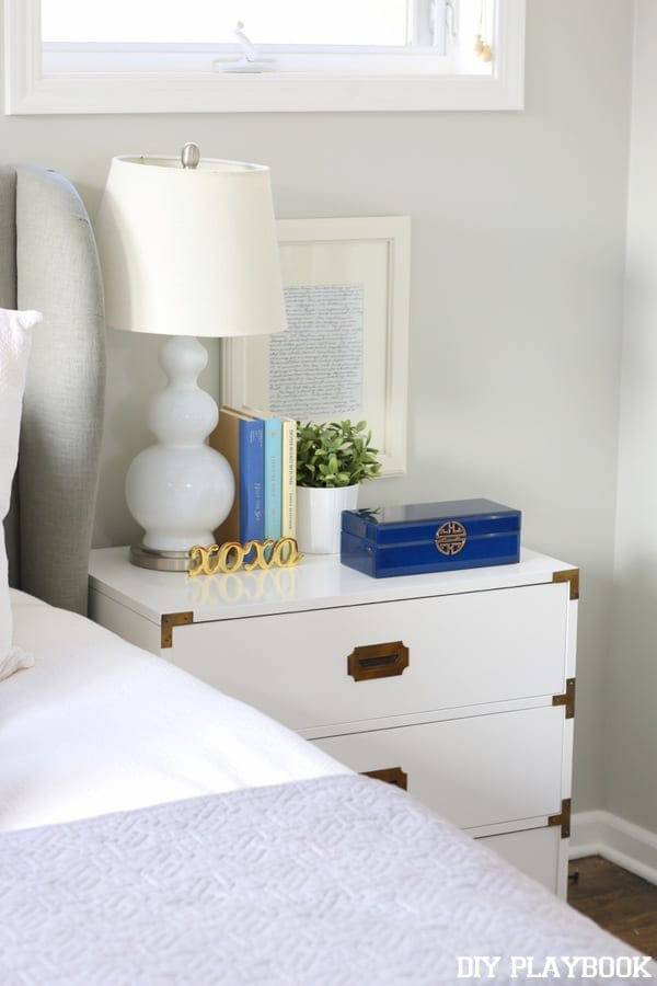 Campaign nightstand with white and blue accents.