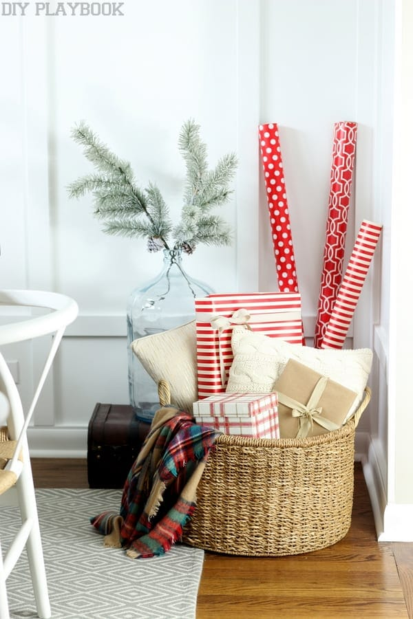 basket of gifts on a fireplace a mantel