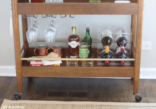 The wood bar cart pairs well with the floors.
