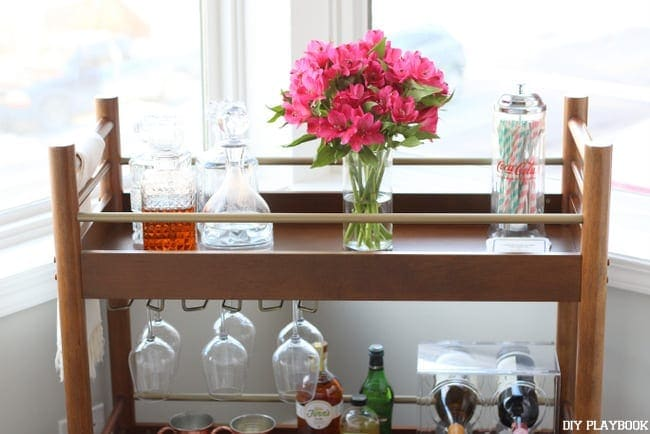 The natural light shines beautifully onto the bar cart.