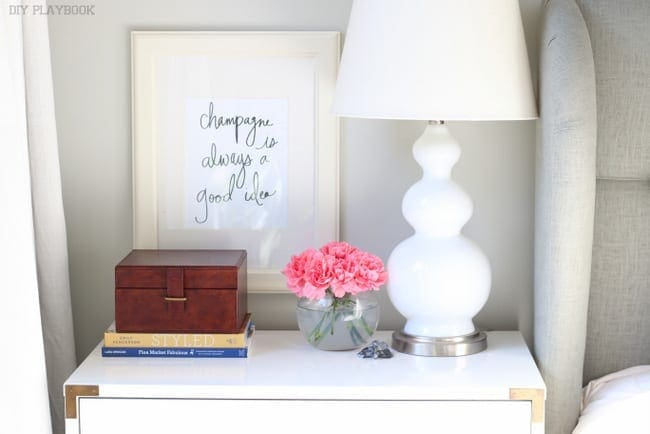 This cute champagne sign adds character to the nightstand.