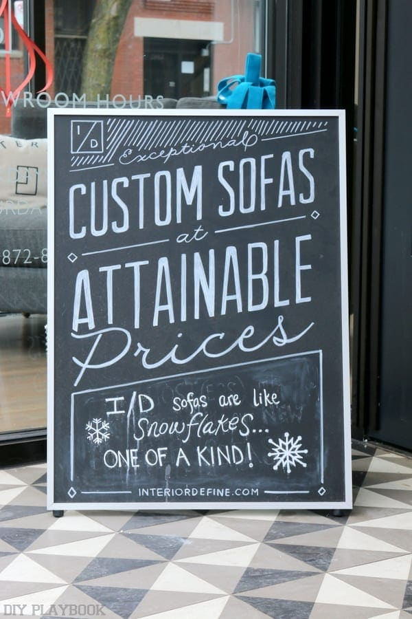 The sign outside of Interior Design reads: Exceptional Custom Sofas at Attainable Prices.