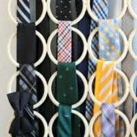 These ties are color coordinated and organized into a new hanger system.
