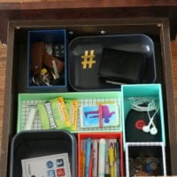 This organized junk drawer has a place for every item.