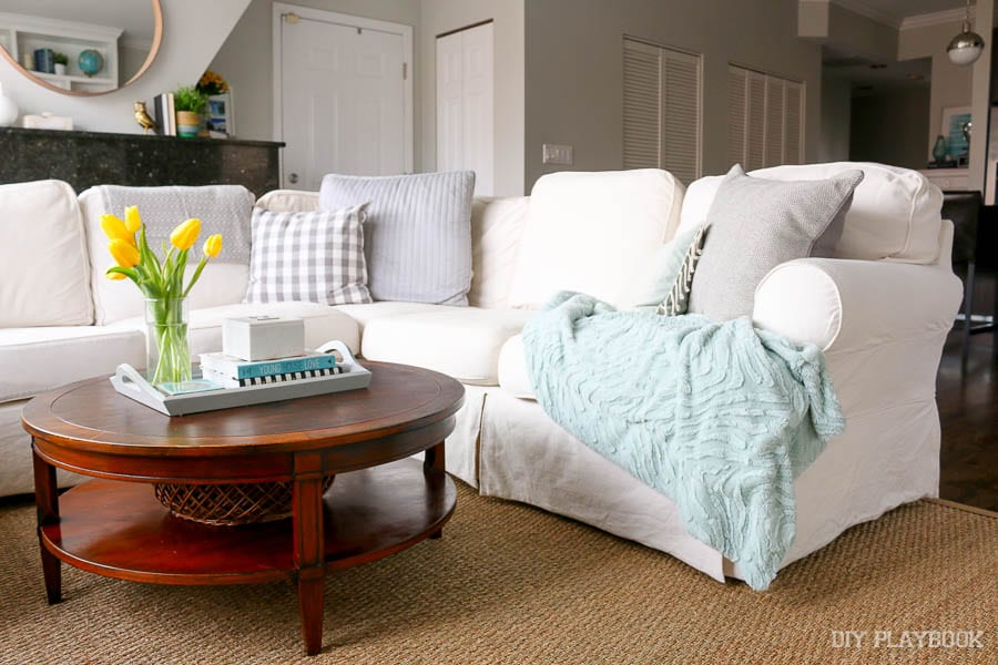 A Throw Blanket is comforting: How to Style Your Couch: Easy DIY Design | DIY Playbook