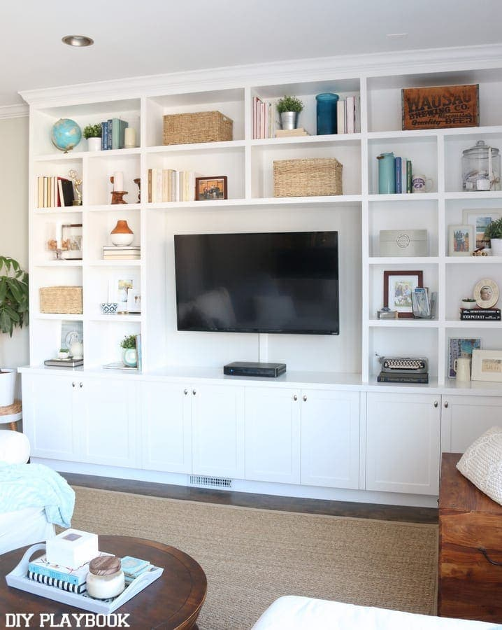 These classic white built-ins around the TV are great for storage and decor.