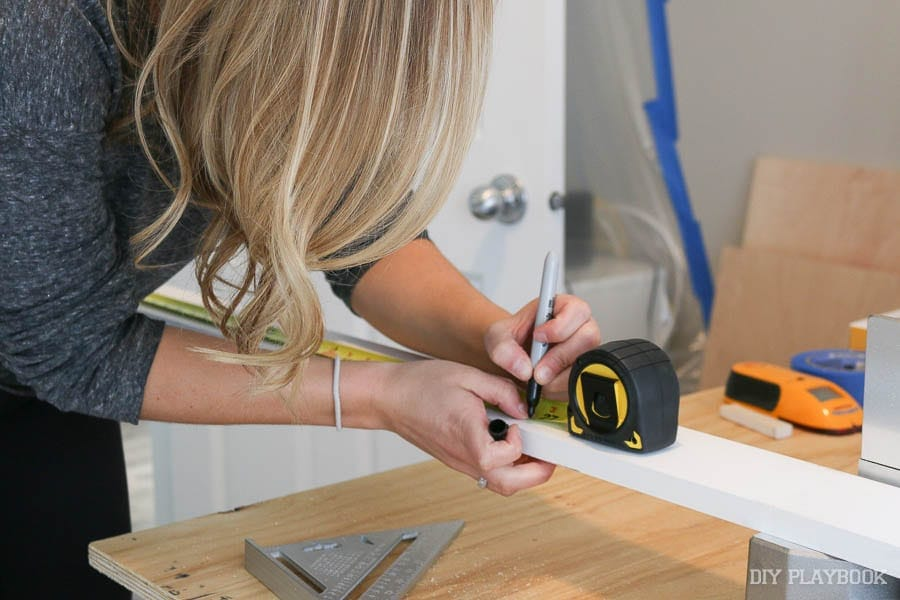 casey-marking-wood-tape-measure