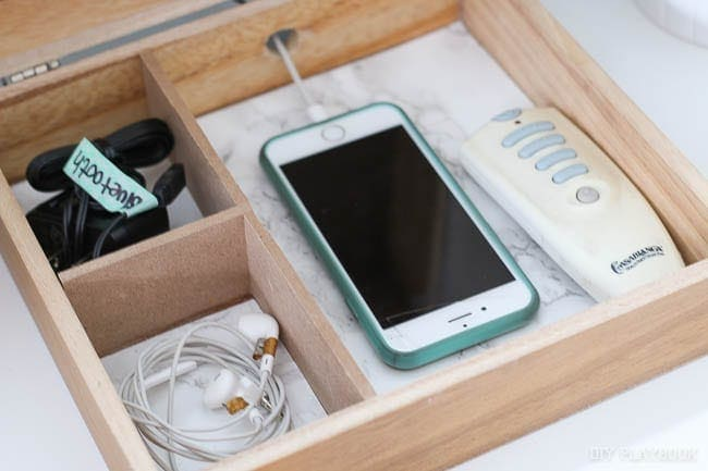 This customized wood cutout piece is great for keeping phone essentials organized.