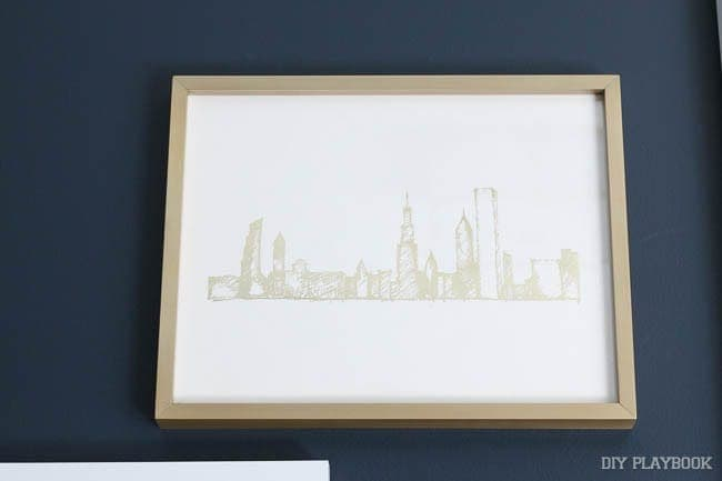 How amazing is this gold Chicago skyline print with a gold frame? So good with the navy wall.