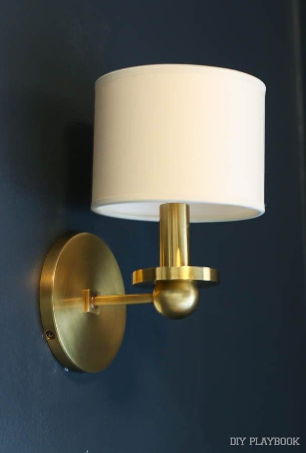 One of two gorgeous gold and white wall sconces. They go together above the credenza we're building!