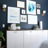 The gallery wall against this dark paint in the guest room really stands out.