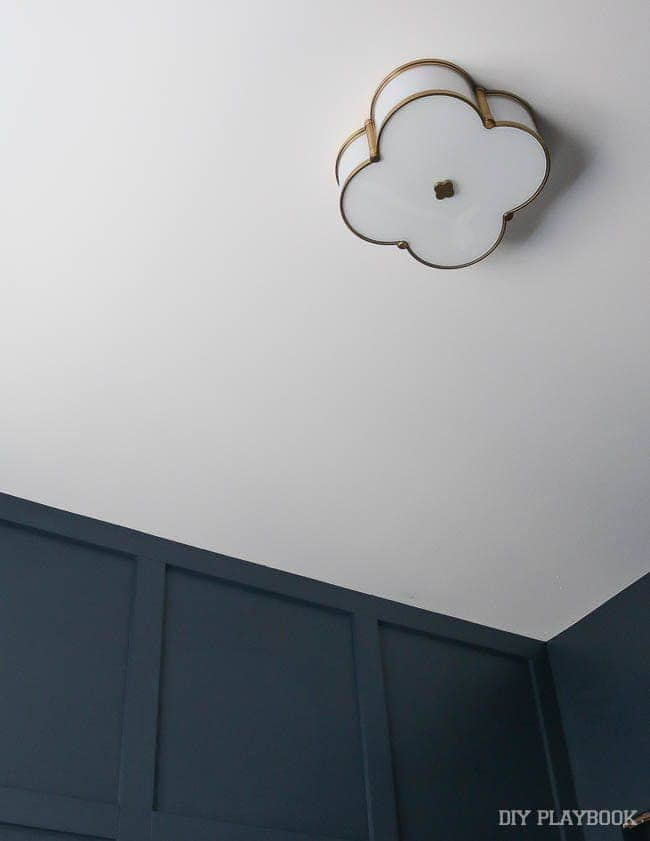 This new light fixture in my guest bedroom provides a warm glow against the dark, blue walls.
