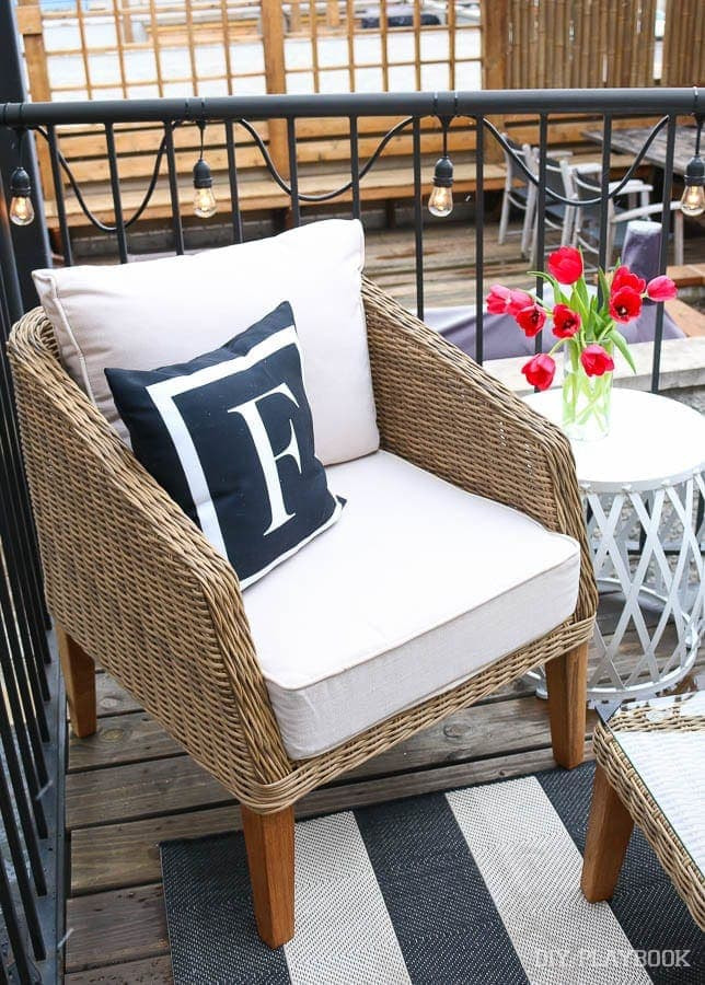 "Another shot of my favorite monogrammed ""F"" pillow! Along with our adorable wicker chair and white garden stool."