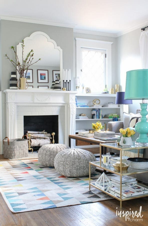 This colorful rug adds to the living room space and compliments the fireplace.