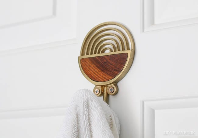 Love this brass and wood towel hook. I put it on the back of the door in the guest room.