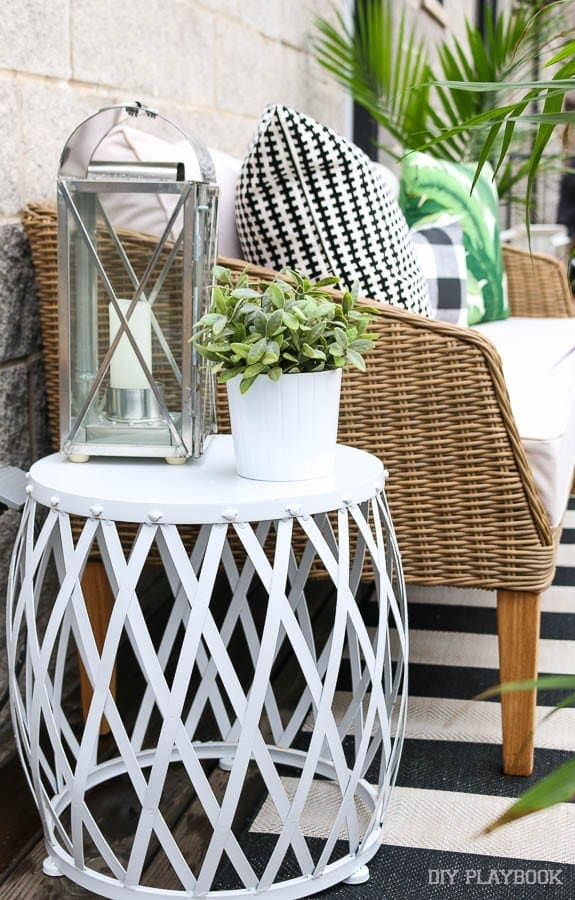 This amazing white garden stool from Home Goods is so versatile - I love the way it looks as a side table.