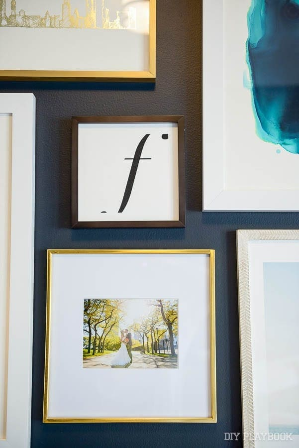 Wall are like monograms and wedding pictures add personalized pieces to the space.