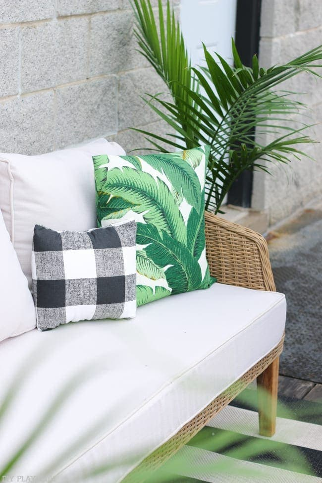 The classic look of the rug let us mix and match patterns more freely, like these palm frond and buffalo check pillows!