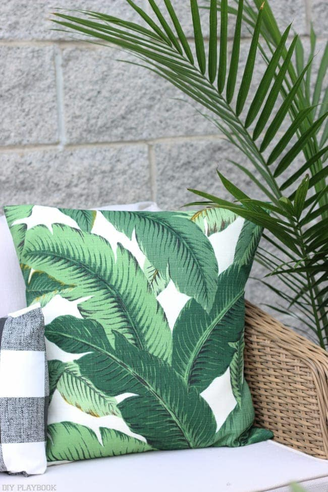 A palm frond throw pillow with outdoor fabric, perfect for the balcony!