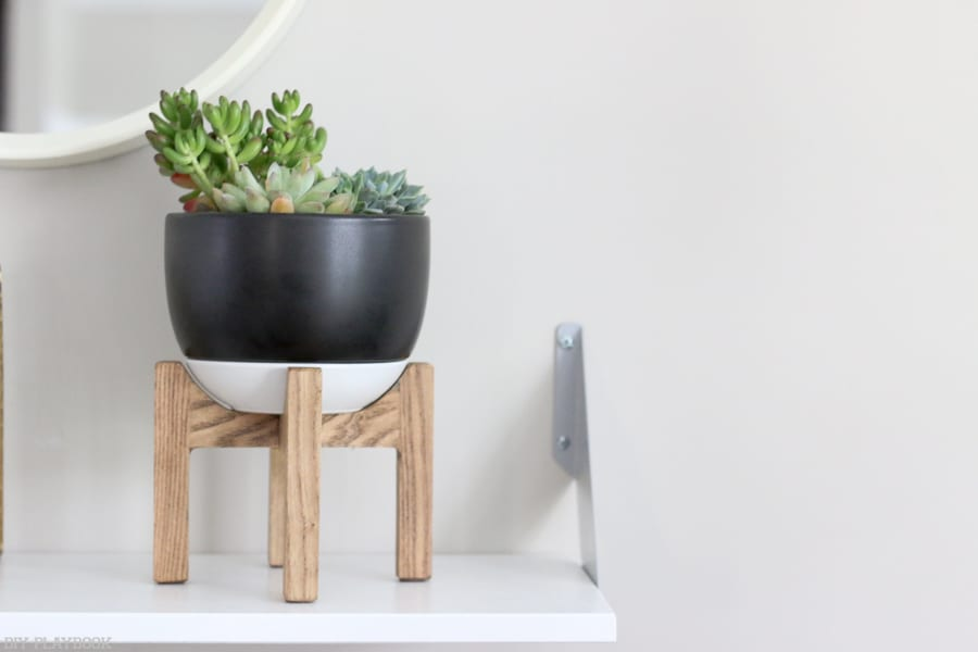 This succulent plat stand is rustic and adorable.