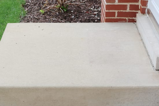 Power washing this home's stoop got rid of any stains or dirt.