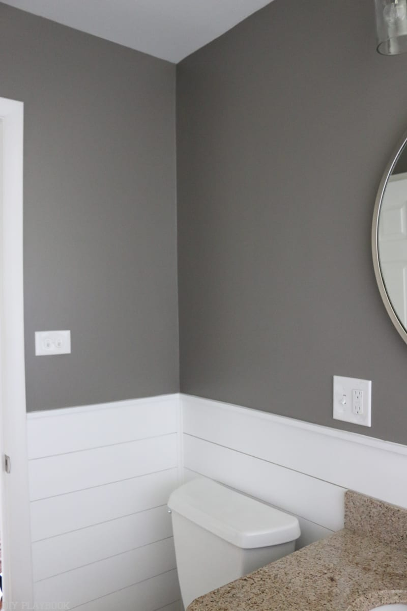Bathroom with bold paint and shiplap makeover.