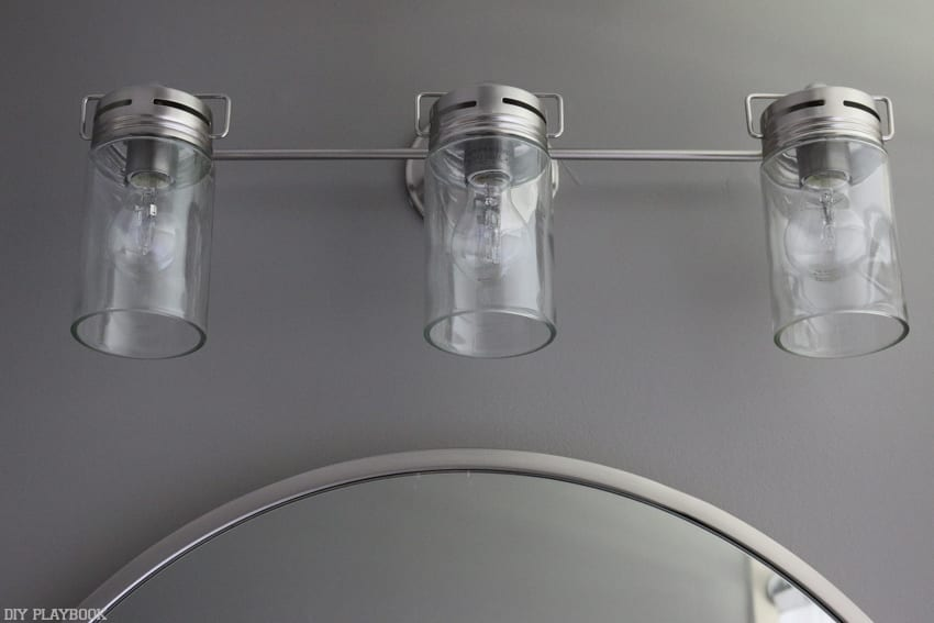 New light fixture in the bathroom makeover--vanity lights with silver accents.