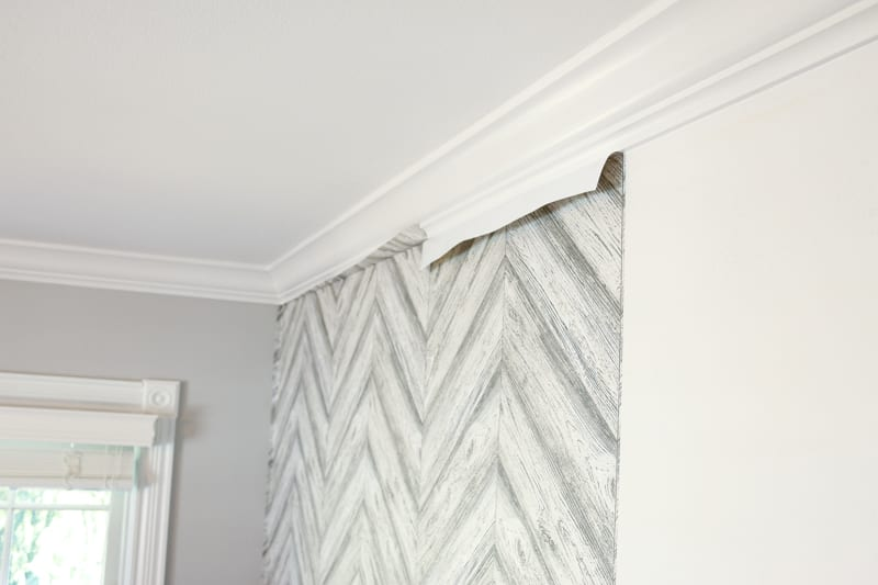 Choose an easy, flat wall to put the wallpaper on.