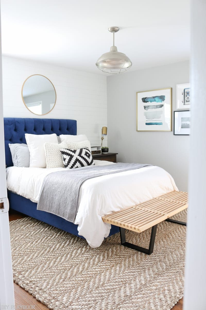 This jute rug works well in this gray bedroom space.