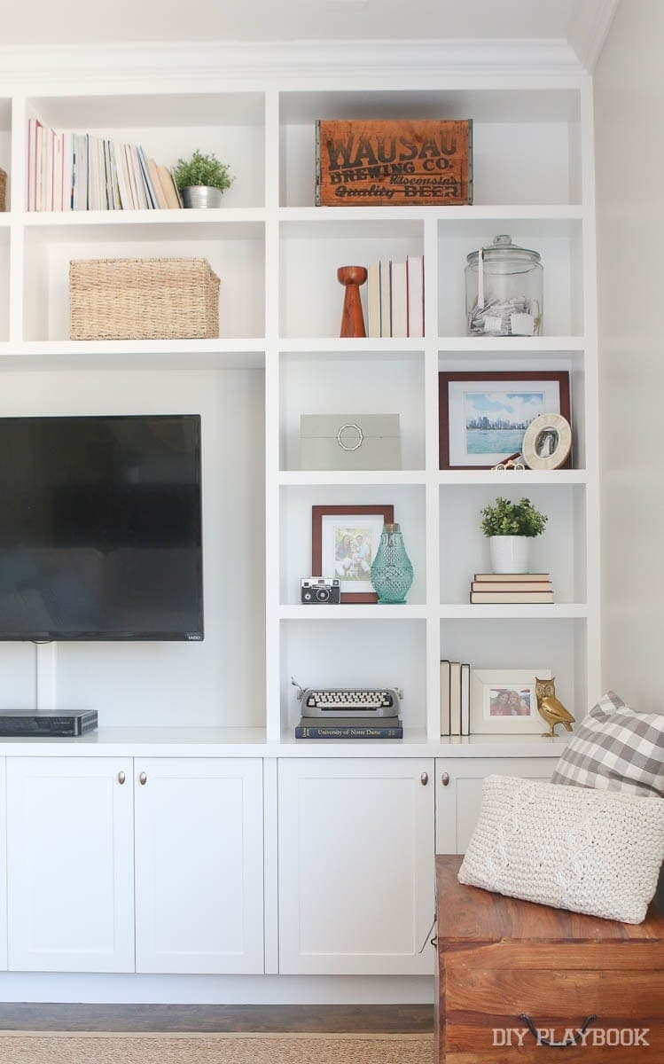 Keep the very meaningful items and display them in some built-in shelves to save space.