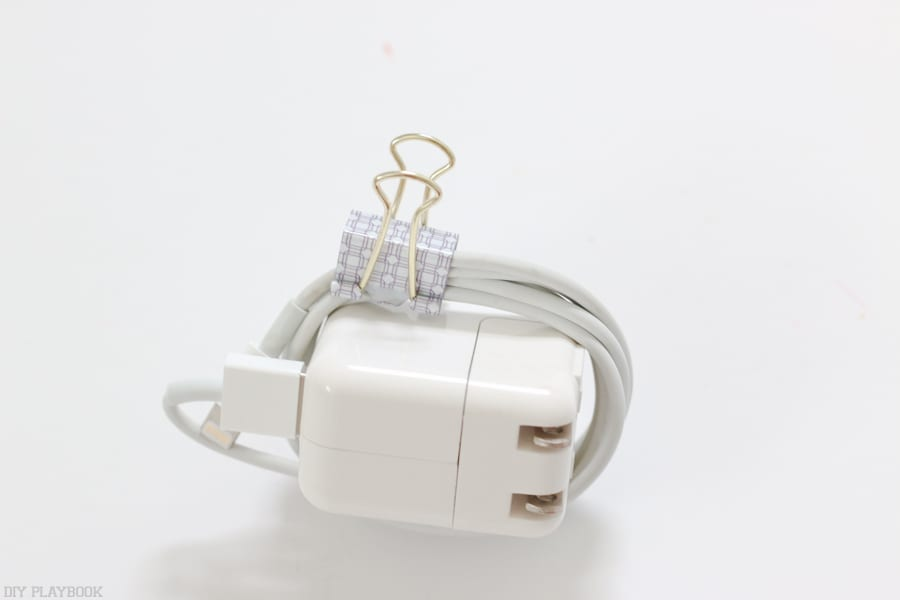 To keep the phone charger organized in the basket, I clip the cord with this binder clip.