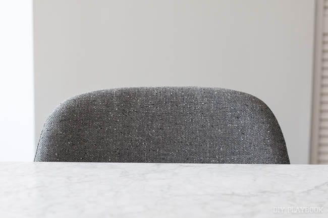Detail shot of the grey chairs with a round back.