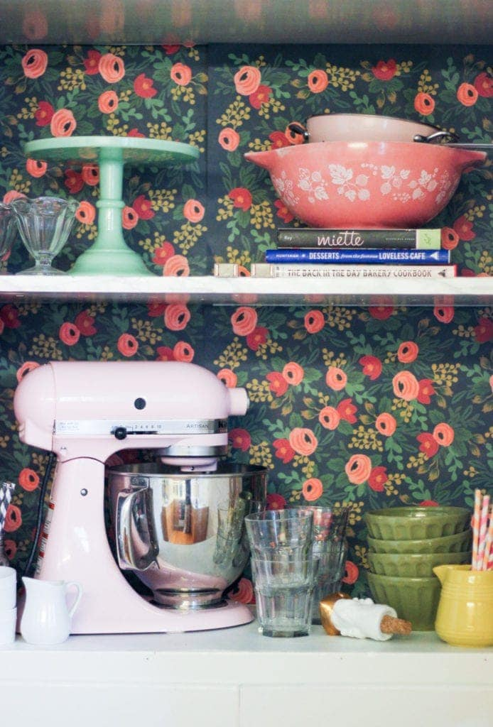 9 Decorating Ideas for Renters: Line the backs of kitchen cabinets with wall paper or other paper that can be easily removed. What a great way to add color!