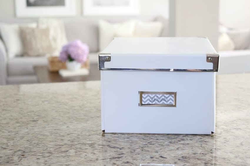 I use a cute white storage box like this one to store little odds and ends like the allen wrench to tighten any loose screws on the chairs.