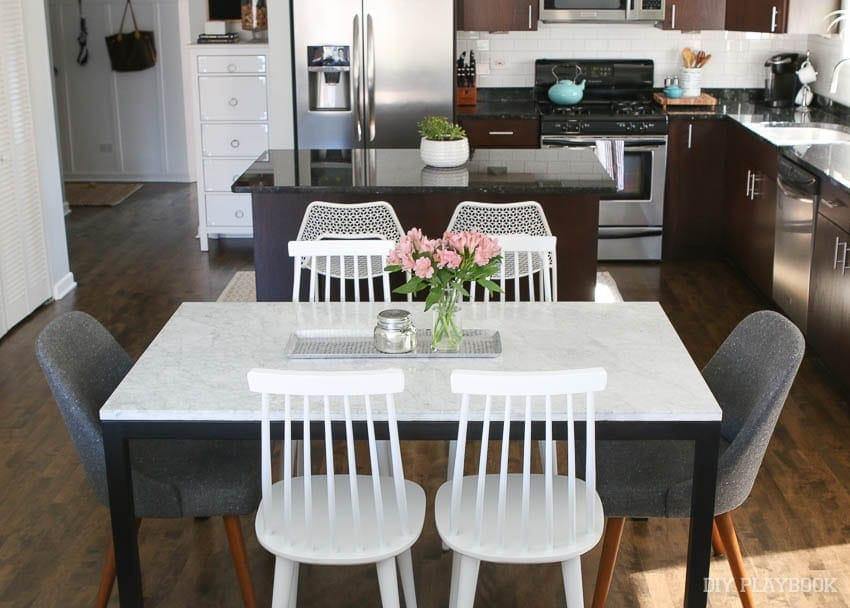 mixing and matching chairs and styles is a fun way to bring style to the room