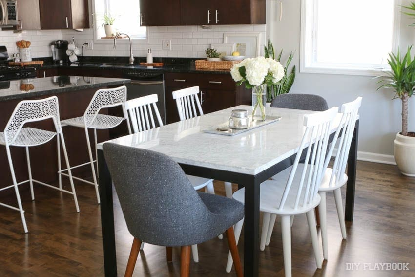 this bright and neutral dining room is small but functiona
