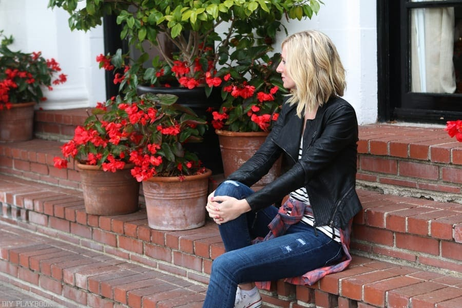 Bridget in Carmel wearing a black leather moto jacket.