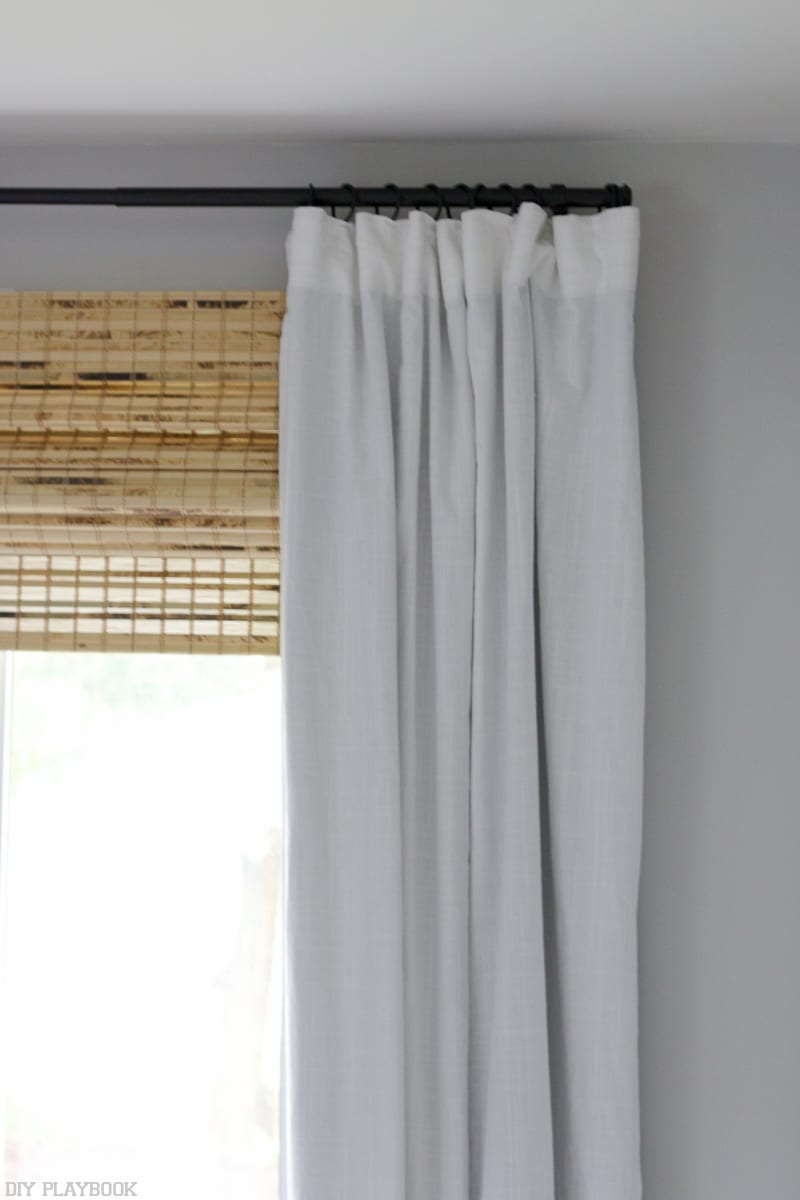 bamboo shades and white curtains