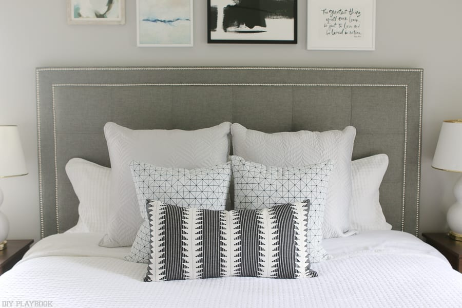 That headboard! This stunning bed and accent pillows are stunning