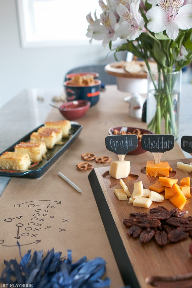 A delicious spread of apps makes any football watch party a great time! Try cheese, nuts and sandwiches for an easy spread.