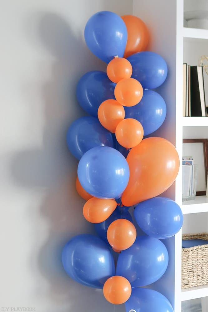Add balloons until the garland is the height you want it to be.
